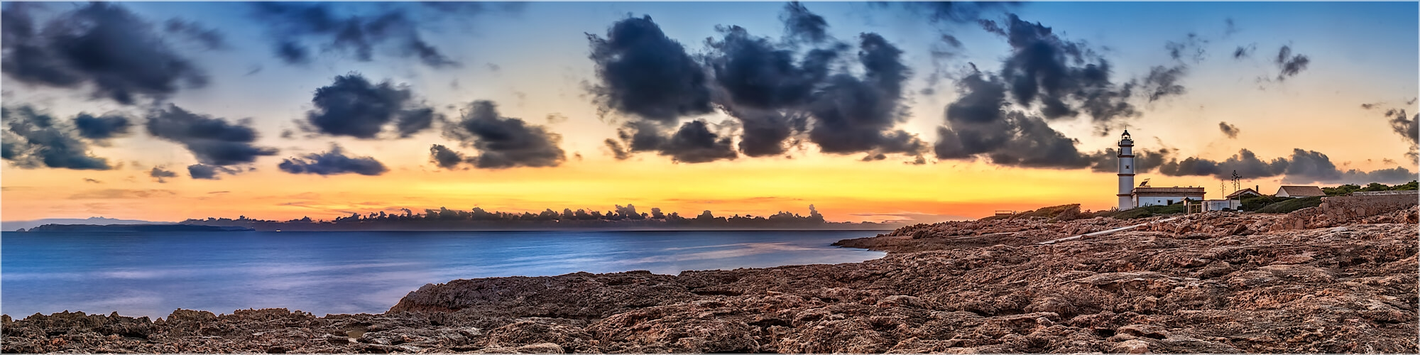 Panoramabild Sonnenuntergang über Ses Salinas Mallorca